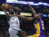 Los Angeles Lakers center Dwight Howard defends as Boston Celtics power forward Jeff Green drives for a second quarter basket as the Boston Celtics...