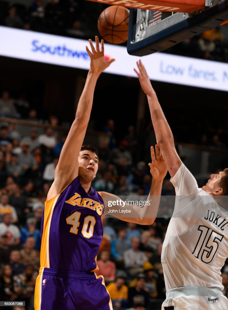 Los Angeles Lakers center Ivica Zubac (40) takes a shot over Denver Nuggets forward Nikola Jokic (15) during the third quarter on March 13, 2017 in Denver, Colorado at Pepsi Center.