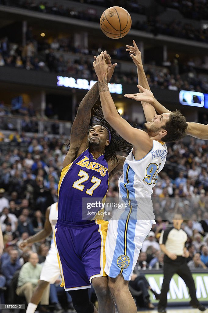 Los Angeles Lakers center Jordan Hill and Denver Nuggets shooting guard Evan Fournier battle for a rebound during the second quarter November 13 2013...