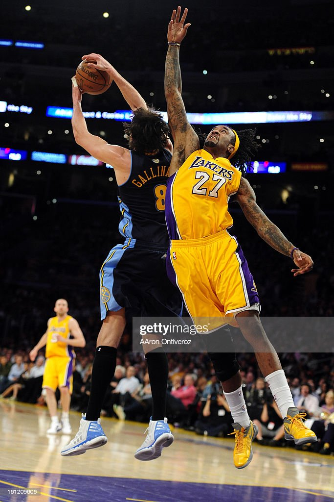 Los Angeles Lakers center Jordan Hill and Denver Nuggets small forward Danilo Gallinari contend for the ball during the first half of game five in...
