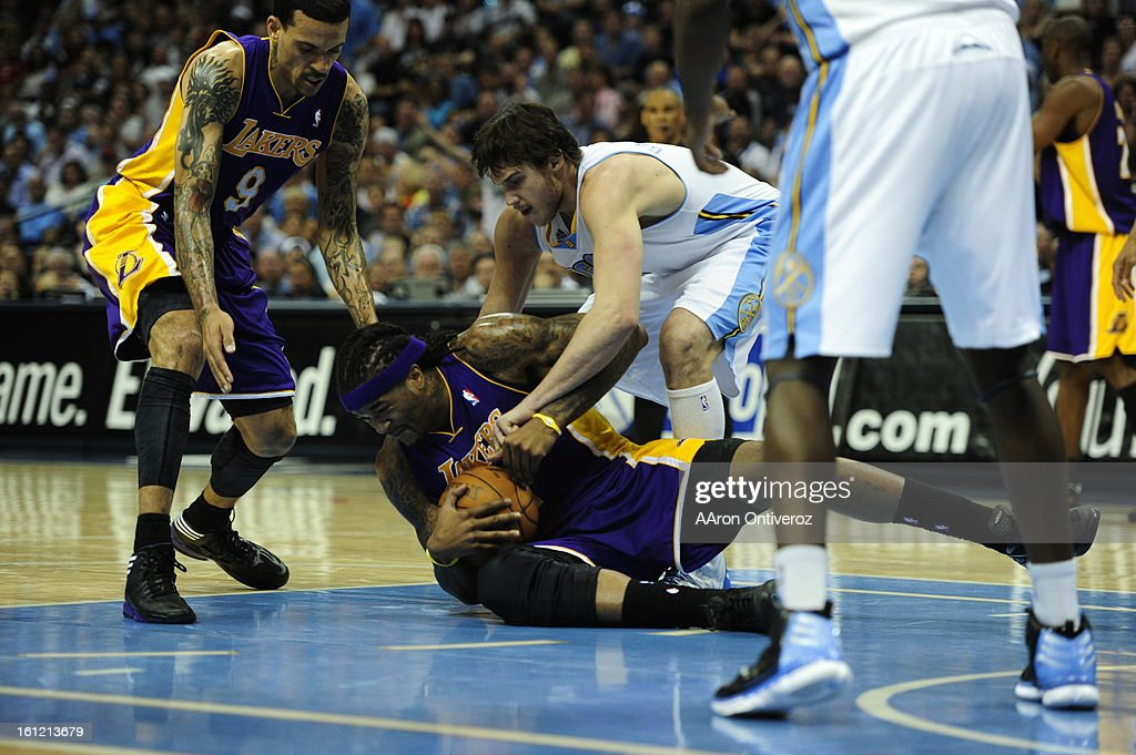 Los Angeles Lakers center Jordan Hill fights for the the ball with Denver Nuggets small forward Danilo Gallinari during the second quarter in game 3...