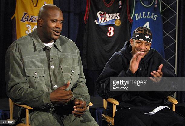 Los Angeles Lakers center Shaquille O''Neal left speaks as Philadelphia 76ers guard Allen Iverson applauds on NBC's 'Meet the Press' February 11 2001...