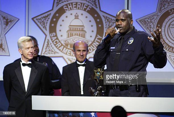 Los Angeles Lakers center Shaquille O'Neal speaks to guests at the 2nd Annual 'California Gold Star Awards' dinner gala and auction at the Disneyland...