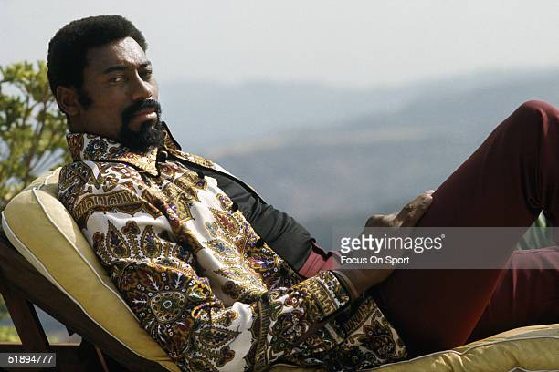 Los Angeles Lakers center Wilt Chamberlain lounges on his deck chair in his backyard