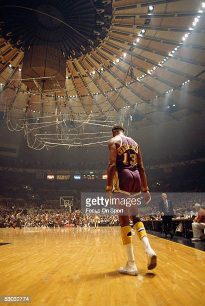 Los Angeles Lakers center Wilt Chamberlain walks back to the action on the court against the New York Knicks during a game at Madison Square Garden...
