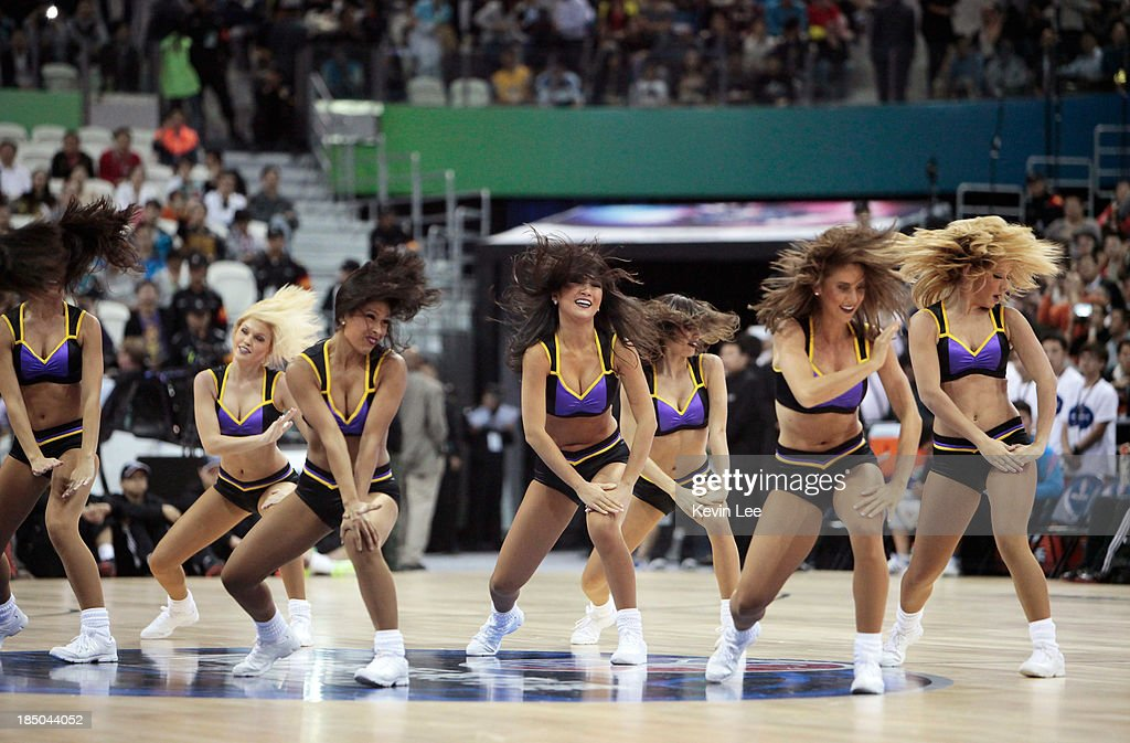 Los Angeles Lakers cheerleaders perform during NBA Fan Appreciation Day on October 17, 2013 in Shanghai, China.