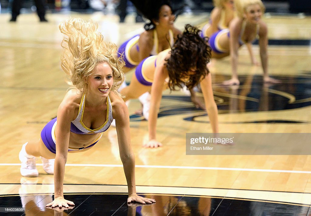 Los Angeles Lakers cheerleaders perform during the team's preseason game against the Sacramento Kings at the MGM Grand Garden Arena on October 10, 2013 in Las Vegas, Nevada. Sacramento won 104-86.
