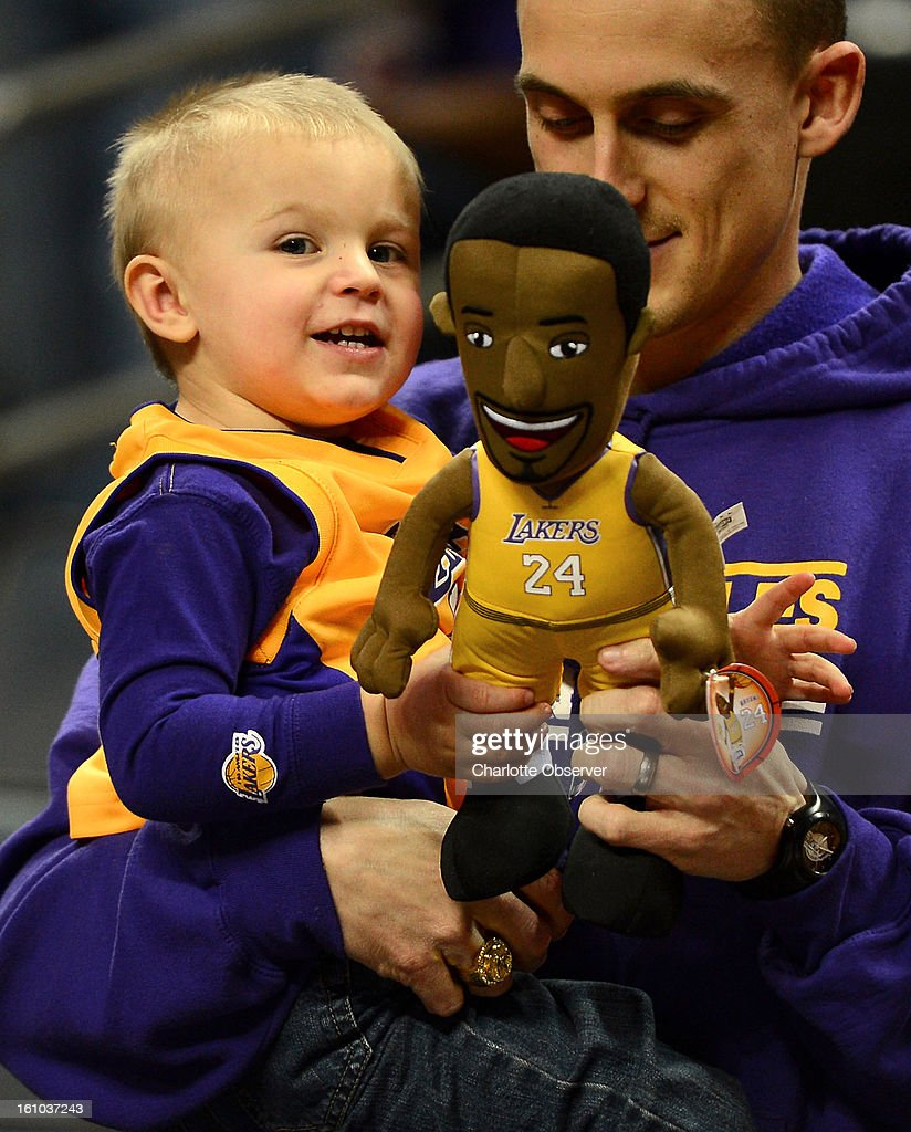 Los Angeles Lakers fan William Boatright, 21 months, plays with his Kobe Bryant doll as his father, Joshua Boatright, holds him prior to the Lakers game against the Charlotte Bobcats at Time Warner Cable Arena in Charlotte, North Carolina, Friday, February 8, 2013. The Lakers defeated the Bobcats 100-93.