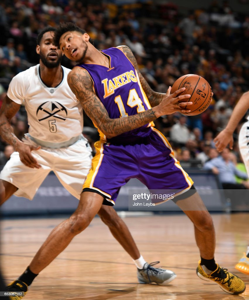Los Angeles Lakers forward Brandon Ingram (14) puts a spin move on Denver Nuggets guard Will Barton (5) during the fourth quarter on March 13, 2017 in Denver, Colorado at Pepsi Center.