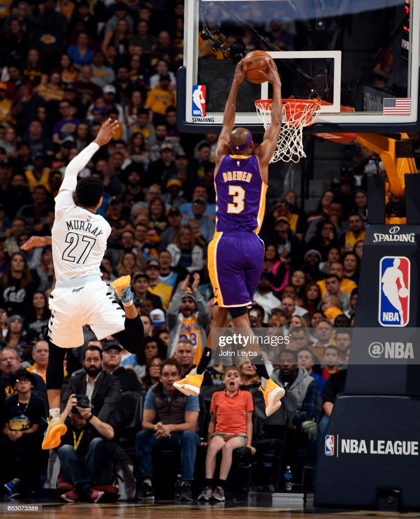 Los Angeles Lakers forward Corey Brewer (3) goes up for a dunk past Denver Nuggets guard Jamal Murray (27) during the second quarter on March 13, 2017 in Denver, Colorado at Pepsi Center.