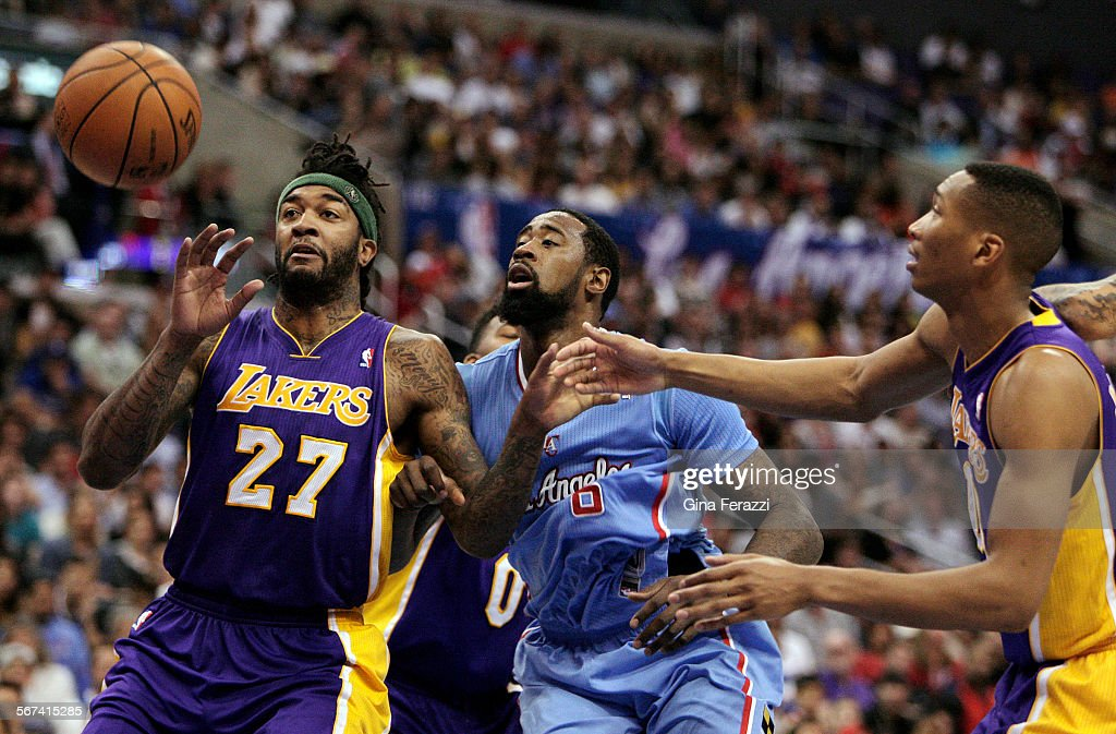 Los Angeles Lakers forward Jordan Hill gets the inside position for a rebound against Los Angeles Clippers center DeAndre Jordan and Los Angeles...