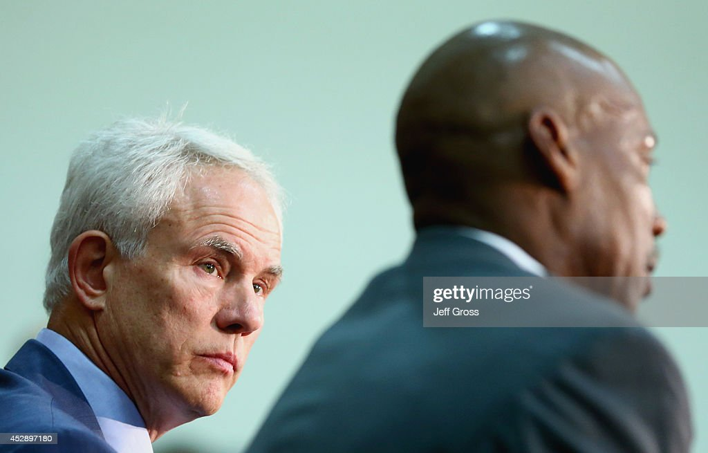 Los Angeles Lakers general manager Mitch Kupchak looks on, as Byron Scott addresses the media during a press conference to introduce Scott as the new head coach of the Los Angeles Lakers at Toyota Sports Center on July 29, 2014 in El Segundo, California.