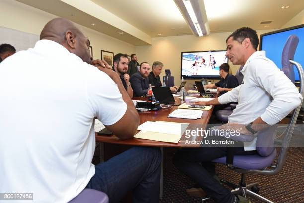Los Angeles Lakers General Manager Rob Pelinka and President of Basketball Operations Magic Johnson talk in the draft room during the 2017 NBA Draft...