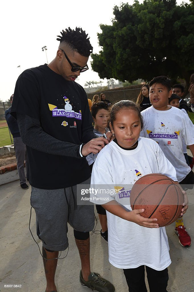 Los Angeles Lakers guard D'Angelo Russell, along with other players, coaches, and the Laker Girls hosts a holiday party for 100 kids from LAs BEST at Gordon Clubhouse on December 10, 2016 in El Segundo, California.