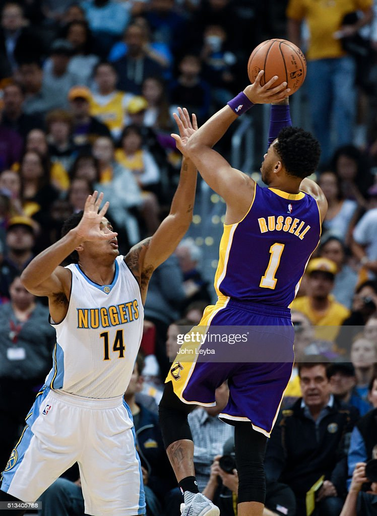 Los Angeles Lakers guard <a gi-track='captionPersonalityLinkClicked' href=/galleries/search?phrase=D%27Angelo+Russell&family=editorial&specificpeople=9612479 ng-click='$event.stopPropagation()'>D'Angelo Russell</a> (1) takes a shot over Denver Nuggets guard <a gi-track='captionPersonalityLinkClicked' href=/galleries/search?phrase=Gary+Harris+-+Basketball+Player&family=editorial&specificpeople=10612733 ng-click='$event.stopPropagation()'>Gary Harris</a> (14) during the first quarter March 2, 2016 at Pepsi Center.