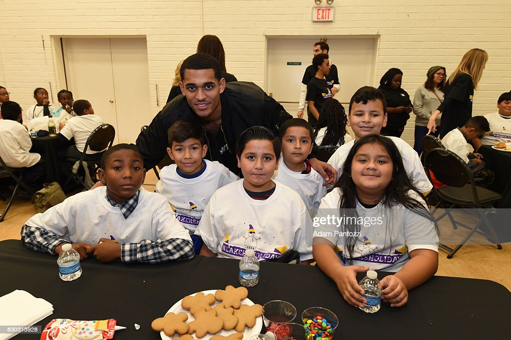 Los Angeles Lakers guard Jordan Clarkson, along with other players, coaches, and the Laker Girls hosts a holiday party for 100 kids from LAs BEST at Gordon Clubhouse on December 10, 2016 in El Segundo, California.