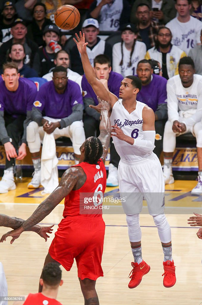 Los Angeles Lakers guard Jordan Clarkson (#6) goes up for a shot against Los Angeles Clippers center DeAndre Jordan (#6) during their NBA game at Staples Center in Los Angeles, California on December 25, 2016. / AFP / RINGO