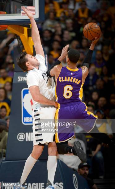 Los Angeles Lakers guard Jordan Clarkson takes a shot on Denver Nuggets forward Danilo Gallinari during the first quarter on March 13 2017 in Denver...