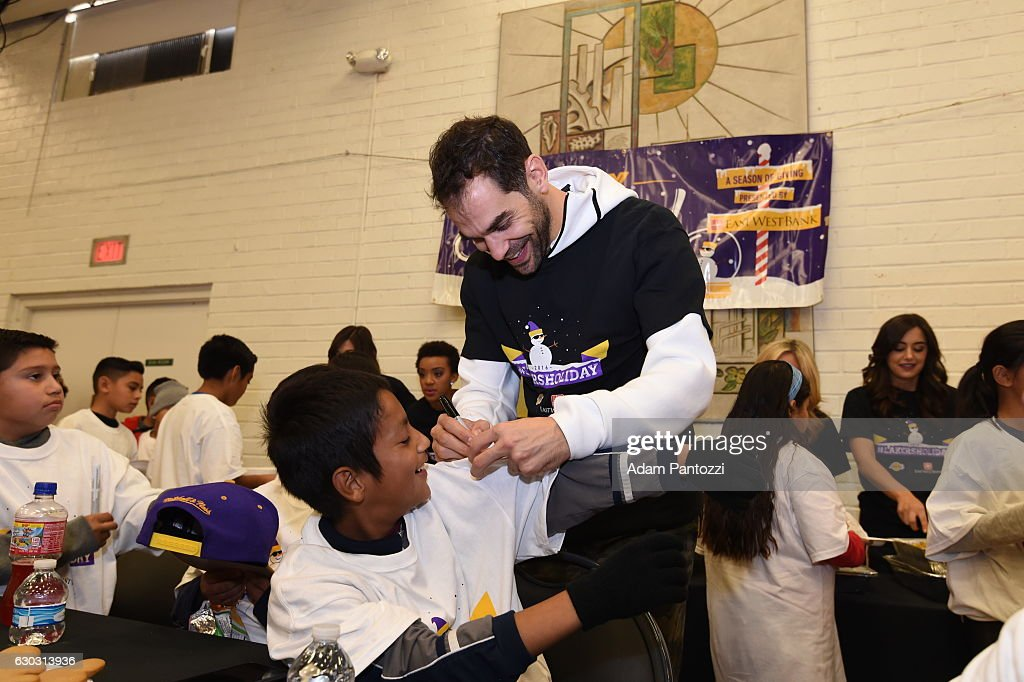 Los Angeles Lakers guard Jose Calderon, along with other players, coaches, and the Laker Girls hosts a holiday party for 100 kids from LAs BEST at Gordon Clubhouse on December 10, 2016 in El Segundo, California.