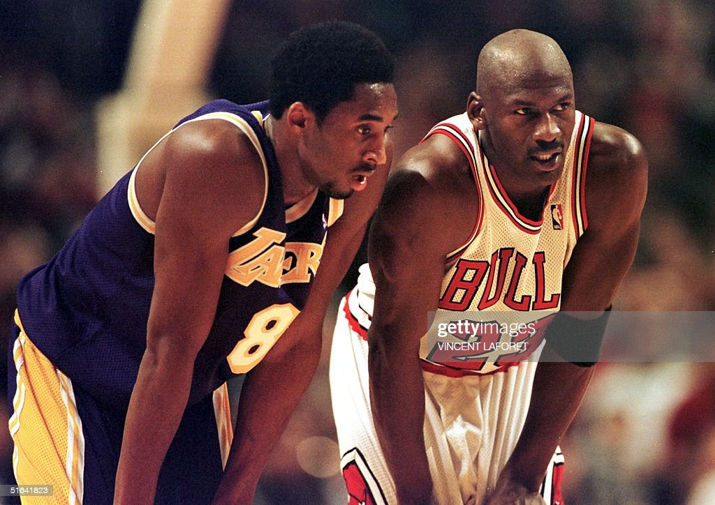Los Angeles Lakers guard <a gi-track='captionPersonalityLinkClicked' href=/galleries/search?phrase=Kobe+Bryant&family=editorial&specificpeople=201466 ng-click='$event.stopPropagation()'>Kobe Bryant</a>(L) and Chicago Bulls guard <a gi-track='captionPersonalityLinkClicked' href=/galleries/search?phrase=Michael+Jordan+-+Basketball+Player&family=editorial&specificpeople=73625 ng-click='$event.stopPropagation()'>Michael Jordan</a>(R) talk during a free-throw attempt during the fourth quarter 17 December at the United Center in Chicago. Bryant, who is 19 and bypassed college basketball to play in the NBA, scored a team-high 33 points off the bench, and Jordan scored a team-high 36 points. The Bulls defeated the Lakers 104-83.