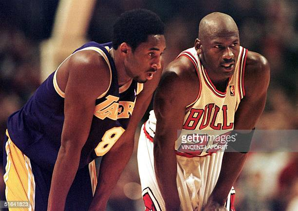 Los Angeles Lakers guard Kobe Bryant and Chicago Bulls guard Michael Jordan talk during a freethrow attempt during the fourth quarter 17 December at...