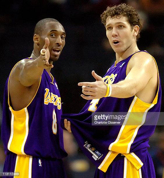 Los Angeles Lakers guard Kobe Bryant talks with teammate Luke Walton during a break in first half action against the Charlotte Bobcats The Bobcats...