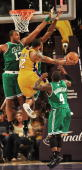 Los Angeles Lakers guard Shannon Brown goes to the basket against Boston Celtics forward/center Shelden Williams and guard Nate Robinson during game...