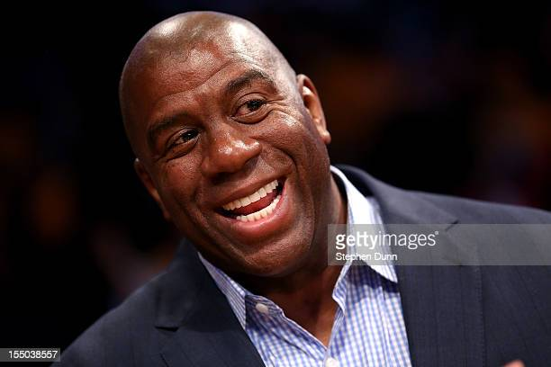 Los Angeles Lakers Hall of Fame player and current part owner of the Los Angeles Dodgers Magic Johnson attends the game with the Dallas Mavericks at...