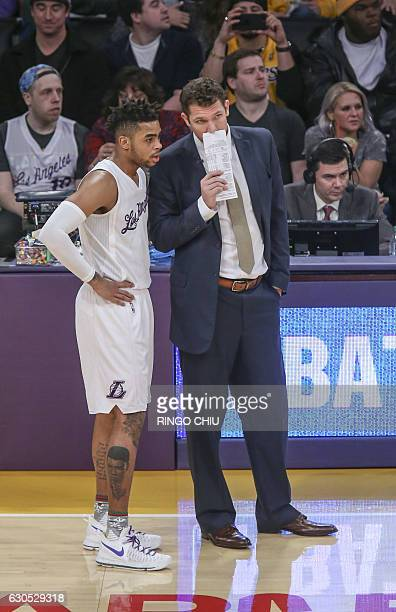 Los Angeles Lakers head coach Luke Walton talks to his guard DÕAngelo Russell during their NBA game at Staples Center in Los Angeles California on...
