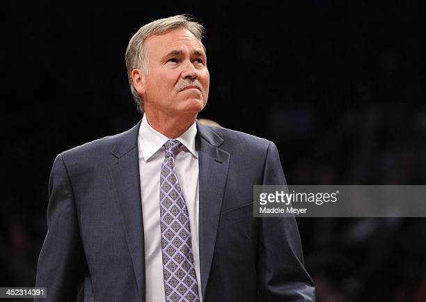Los Angeles Lakers head coach Mike D'Antoni looks on during the first half against the Brooklyn Nets at Barclays Center on November 27 2013 in the...
