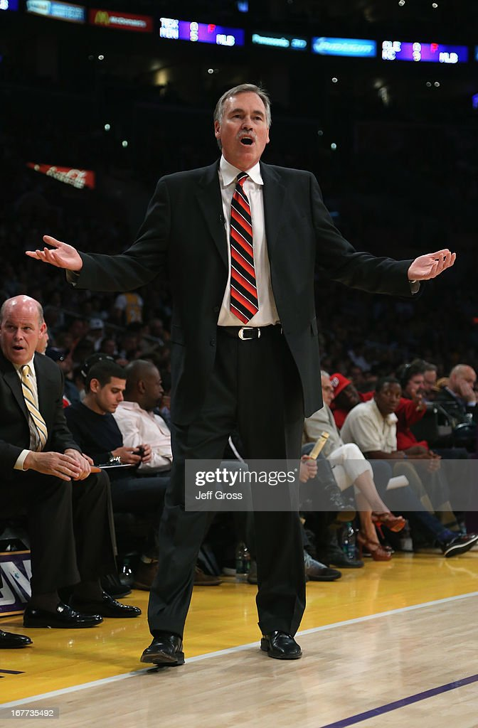 Los Angeles Lakers head coach Mike D'Antoni questions a call in the first half against the San Antonio Spurs during Game Four of the Western Conference Quarterfinals of the 2013 NBA Playoffs at Staples Center on April 28, 2013 in Los Angeles, California. The Spurs defeated the Lakers 103-82.