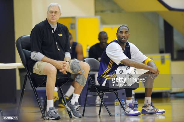 Los Angeles Lakers head coach Phil Jackson and Kobe Bryant look on during practice on December 3 2009 at Toyota Sports Center in El Segundo...