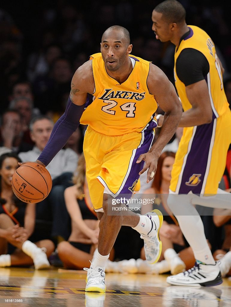 Los Angeles Lakers Kobe Bryant brings the ball upcourt during their Lakers NBA match up against the Suns at Staples Center in Los Angeles, California, February 12, 2013. The Lakers defeated the Suns, 91-85. AFP PHOTO Robyn BECK