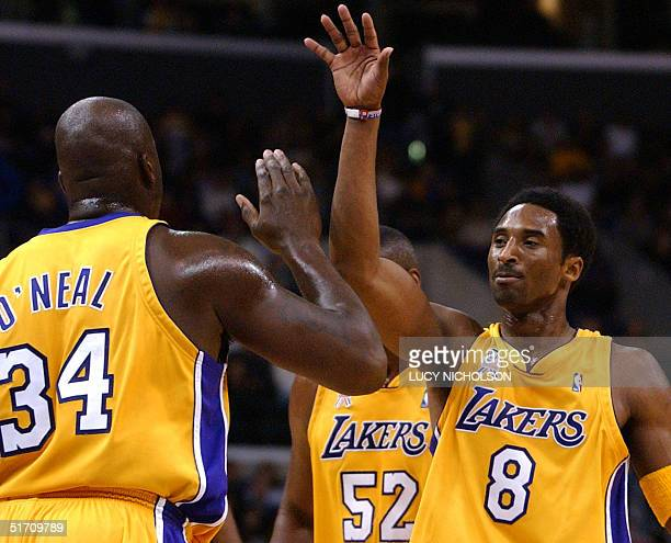 Los Angeles Lakers' Kobe Bryant celebrates with teammate Shaquille O'Neal after scoring in the third quarter at the Staples Center in Los Angeles 01...