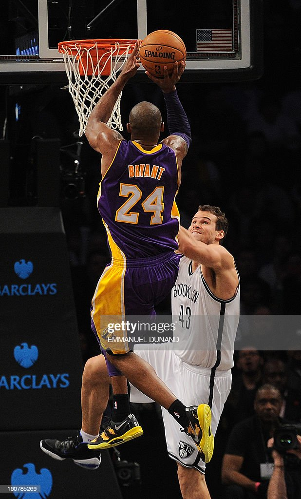 Los Angeles Lakers' Kobe Bryant drives the ball against the Brooklyn Nets' Kris Humphries during their NBA game at the Barclays Center in the Brooklyn borough of New York City, February 5, 2013. AFP PHOTO/Emmanuel Dunand