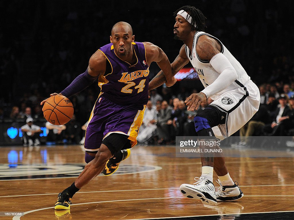 Los Angeles Lakers' Kobe Bryant drives the ball past Brooklyn Nets Gerald Wallace during their NBA game at the Barclays Center in the Brooklyn borough of New York City, February 5, 2013. AFP PHOTO/Emmanuel Dunand