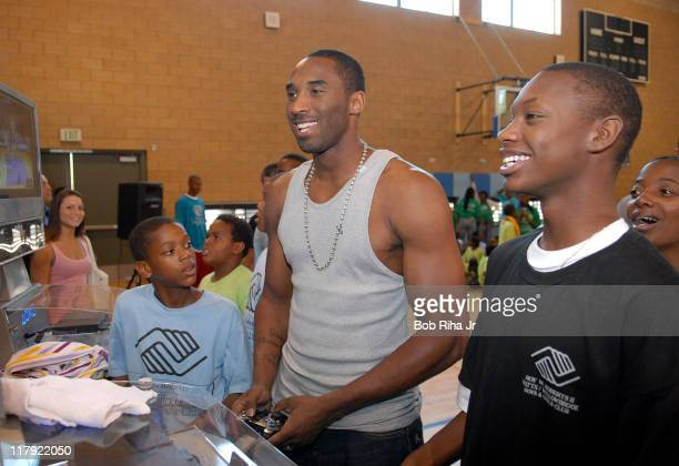 Los Angeles Lakers Kobe Bryant plays against Ronzerra Craft age 17 as Keilyn Faulkner age 12 watches the action after announcing the new PlayStation...