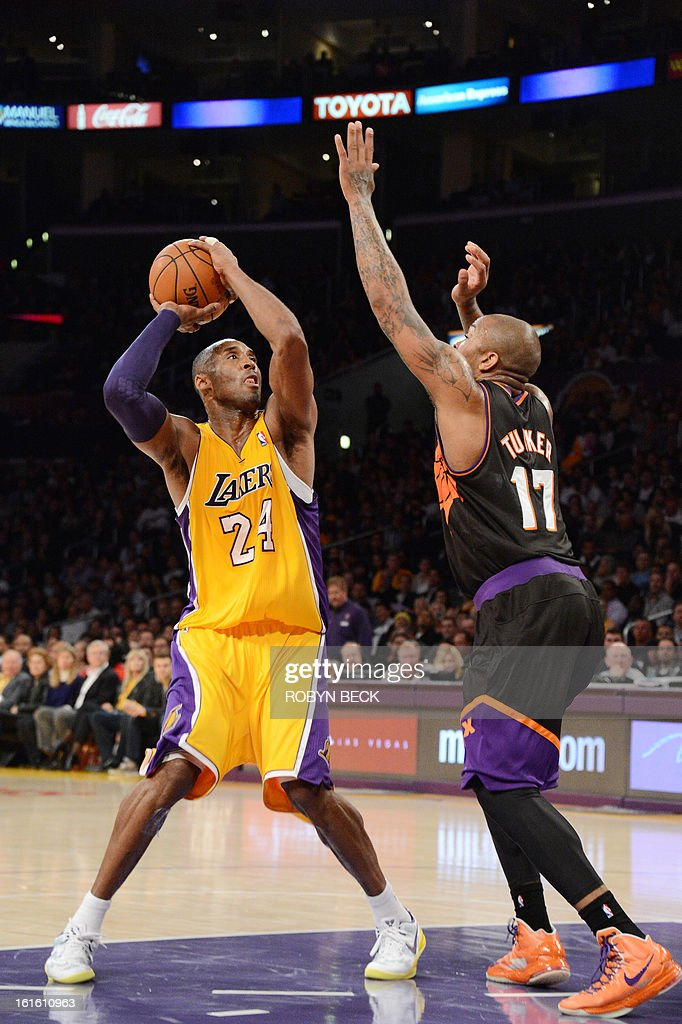 Los Angeles Lakers Kobe Bryant (L) prepares to shoot over Phoenix Suns P.J. Tucker (R) during the Lakers NBA match up against the Suns, at Staples Center in Los Angeles, California, February 12, 2013. The Lakers defeated the Suns, 91-85. Kobe Bryant finishes with only four points, nine assists and eight turnovers. AFP PHOTO Robyn BECK