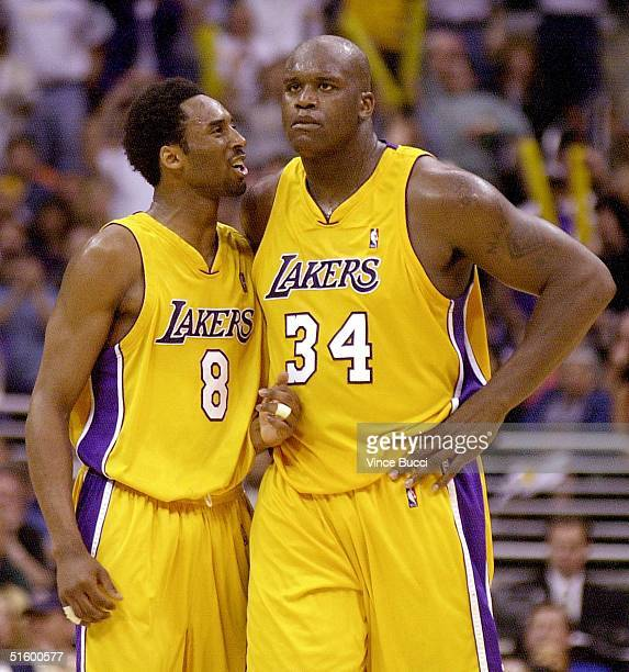 Los Angeles Lakers Kobe Bryant talks to teammate Shaquille O'Neal late in the 4th quarter during Game One of the NBA Western Conference first round...