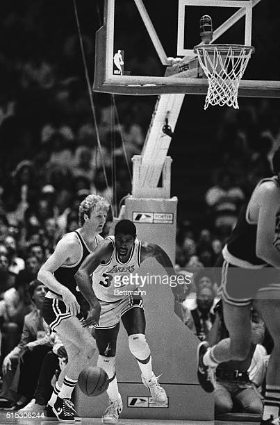 Los Angeles Laker's Magic Johnson gets out in front of Boston Celtics Larry Bird as they go after a loose ball during the 4th period action at the...