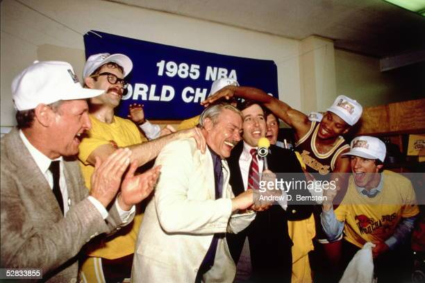 Los Angeles Lakers Owner Jerry Buss and his team celebrate in the locker room after winning the 1985 NBA Finals against the Boston Celtics on June 9...