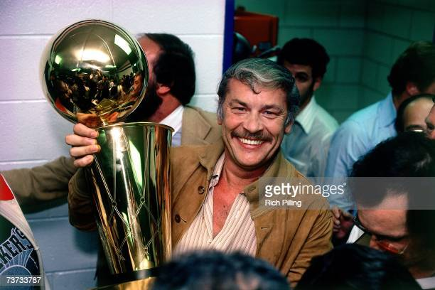 Los Angeles Lakers owner Jerry Buss poses with the NBA Championship trophy after Game 6 of the NBA Finals with the Los Angeles Lakers and the...