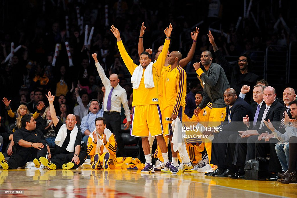 Los Angeles Lakers players celebrate from the bench during a game against the Boston Celtics at Staples Center on February 20, 2013 in Los Angeles, California.
