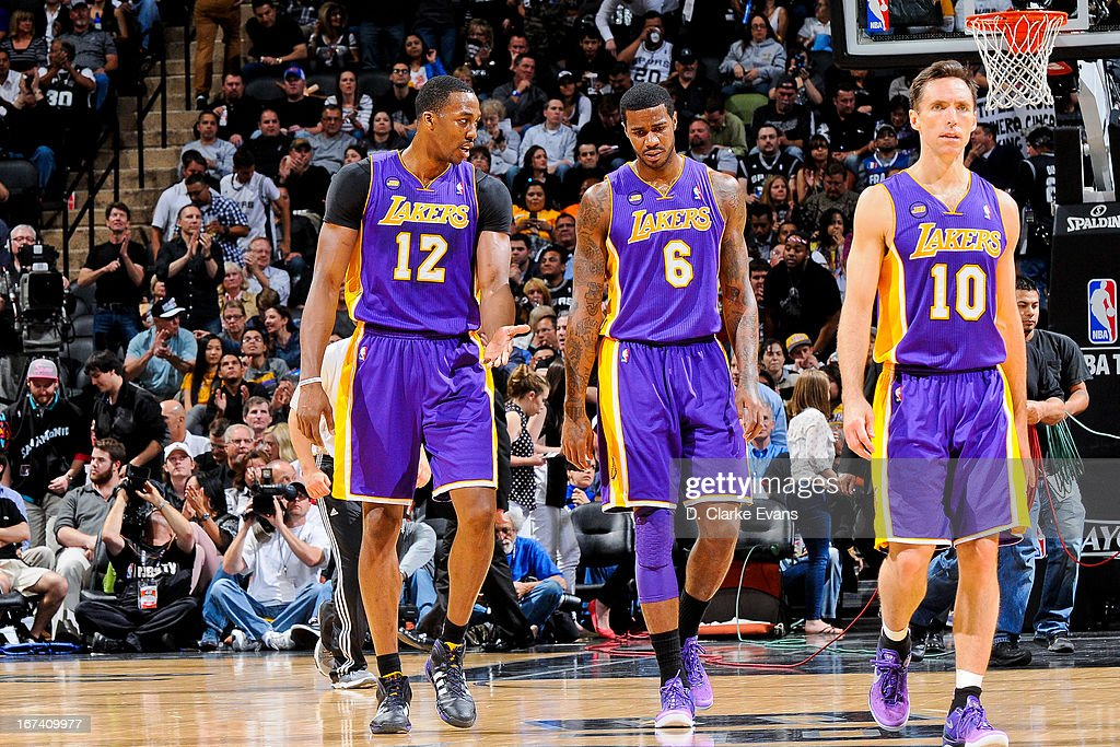 Los Angeles Lakers players Dwight Howard #12, Earl Clark #6 and Steve Nash #10 walk to the sideline while playing against the San Antonio Spurs in Game Two of the Western Conference Quarterfinals during the 2013 NBA Playoffs on April 24, 2013 at the AT&T Center in San Antonio, Texas.