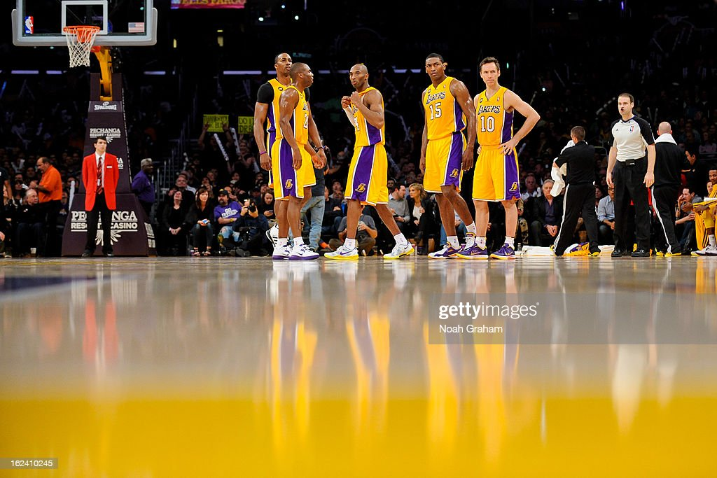 Los Angeles Lakers players, from left, <a gi-track='captionPersonalityLinkClicked' href=/galleries/search?phrase=Dwight+Howard&family=editorial&specificpeople=201570 ng-click='$event.stopPropagation()'>Dwight Howard</a> #12, <a gi-track='captionPersonalityLinkClicked' href=/galleries/search?phrase=Jodie+Meeks&family=editorial&specificpeople=4001727 ng-click='$event.stopPropagation()'>Jodie Meeks</a> #20, <a gi-track='captionPersonalityLinkClicked' href=/galleries/search?phrase=Kobe+Bryant&family=editorial&specificpeople=201466 ng-click='$event.stopPropagation()'>Kobe Bryant</a> #24, Metta World Peace #15 and <a gi-track='captionPersonalityLinkClicked' href=/galleries/search?phrase=Steve+Nash&family=editorial&specificpeople=201513 ng-click='$event.stopPropagation()'>Steve Nash</a> #10 wait to resume action against the Portland Trail Blazers at Staples Center on February 22, 2013 in Los Angeles, California.