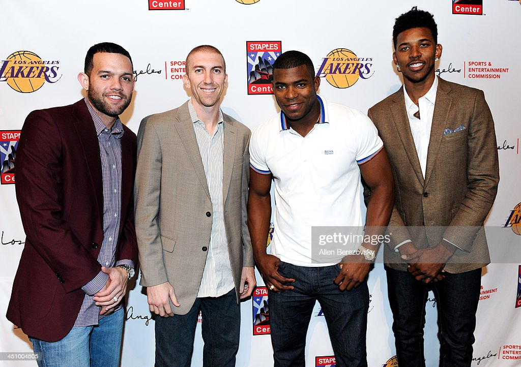 Los Angeles Lakers players <a gi-track='captionPersonalityLinkClicked' href=/galleries/search?phrase=Jordan+Farmar&family=editorial&specificpeople=228137 ng-click='$event.stopPropagation()'>Jordan Farmar</a> (L), <a gi-track='captionPersonalityLinkClicked' href=/galleries/search?phrase=Steve+Blake+-+Basketball+Player&family=editorial&specificpeople=204474 ng-click='$event.stopPropagation()'>Steve Blake</a> and Nick Young (R) pose for a picture with Los Angeles Dodgers star <a gi-track='captionPersonalityLinkClicked' href=/galleries/search?phrase=Yasiel+Puig&family=editorial&specificpeople=10484087 ng-click='$event.stopPropagation()'>Yasiel Puig</a> (2nd from right) at the Los Angeles Sports and Entertainment Commission's 10th annual Lakers All-Access event at Staples Center on November 20, 2013 in Los Angeles, California.