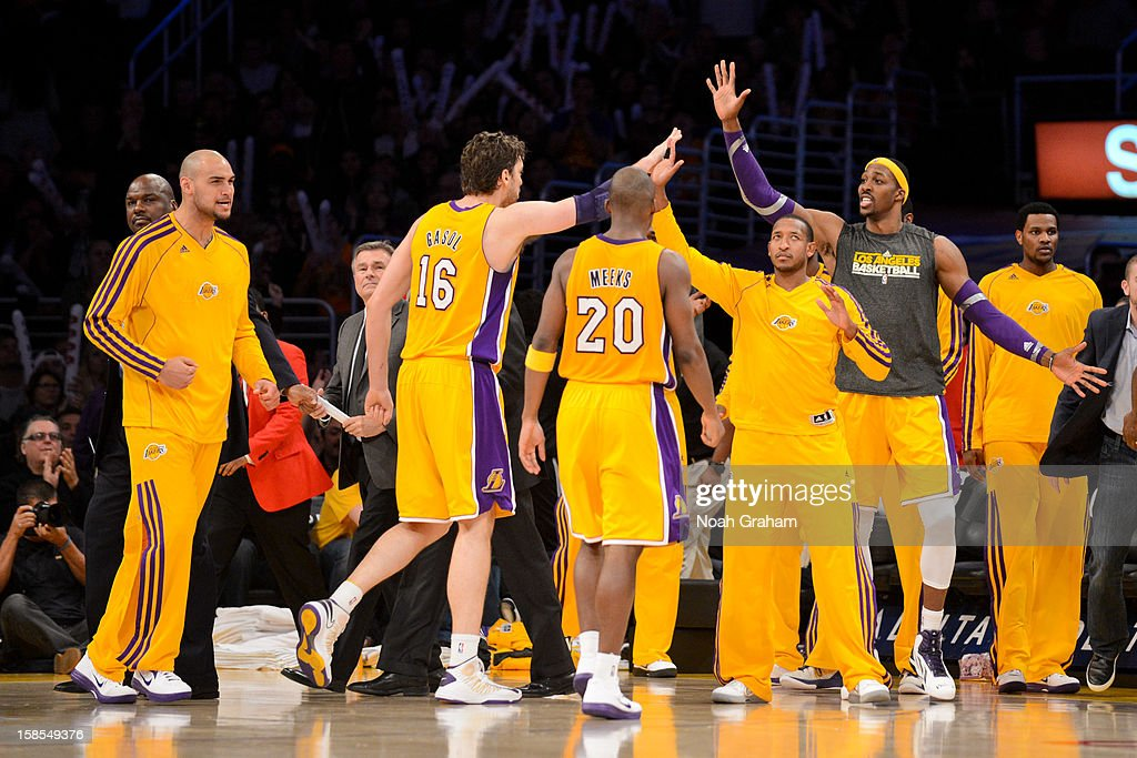 Los Angeles Lakers players Robert Sacre #50, Pau Gasol #16, Jodie Meeks #20, Chris Duhon #21 and Dwight Howard #12 celebrate while playing against the Charlotte Bobcats at Staples Center on December 18, 2012 in Los Angeles, California.