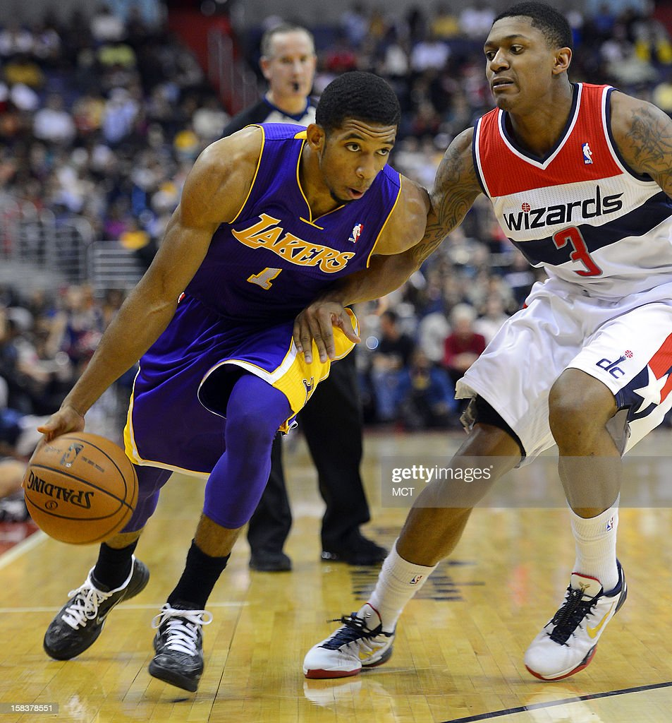 Los Angeles Lakers point guard Darius Morris (1) drives against Washington Wizards shooting guard Bradley Beal (3) in the first half at the Verizon Center in Washington, D.C., Friday, December 14, 2012.