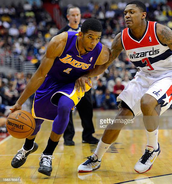 Los Angeles Lakers point guard Darius Morris drives against Washington Wizards shooting guard Bradley Beal in the first half at the Verizon Center in...