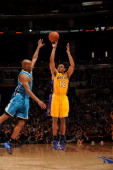 Los Angeles Lakers point guard Shannon Brown goes for a jump shot during the game against the New Orleans Hornets in Game Five of the Western...